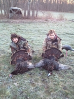 Two youth hunters with their turkeys