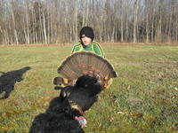 A youth turkey hunter with his turkey.
