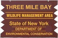 three mile bay brown sign