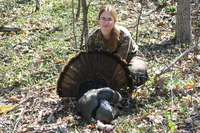 a youth hunter with her turkey