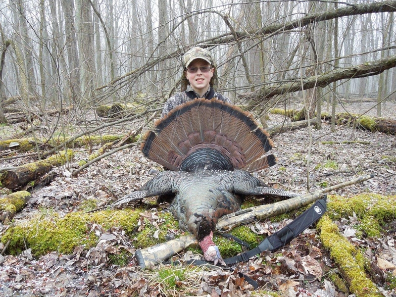 A youth hunter with his turkey
