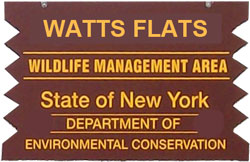 Watts Flats Brown Sign