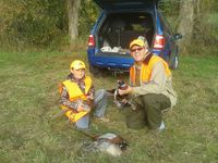 A successful youth duck hunter with his mentor.