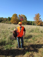 A youth hunter with his pheasant.