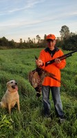 A youth pheasant hunter with his harvest.